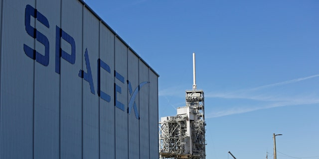 File photo -A SpaceX Falcon 9 rocket (in center, in a horizontal position), is readied for launch on a supply mission to the International Space Station on historic launch pad 39A at the Kennedy Space Center in Cape Canaveral, Florida, U.S., February 17, 2017. (REUTERS/Joe Skipper)