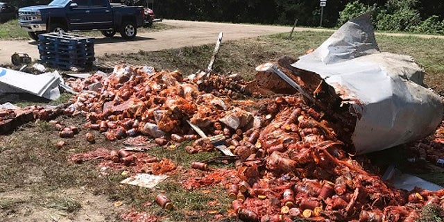 Broken jars of spaghetti sauce littered a road near Camden, Ark. on Aug. 21.