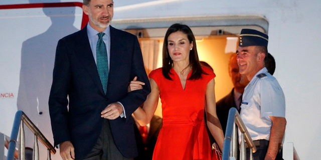 King Felipe VI and Queen Letizia of Spain land in New Orleans Thursday, June 14, 2018 where they were greeted by a jazz band and Mardi Gras Indians.