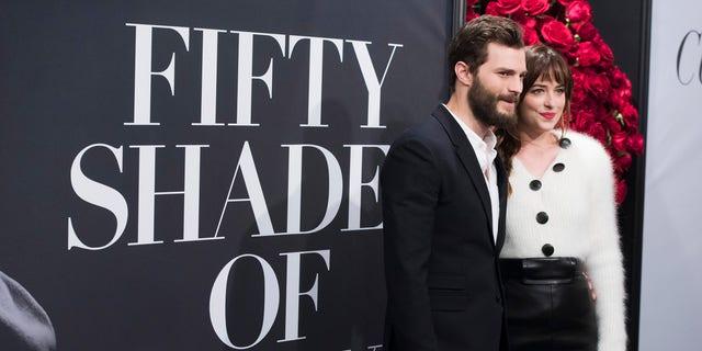 "Feb 6, 2015. Jamie Dornan and Dakota Johnson attend a special fan screening of  ""Fifty Shades of Grey"" at the Ziegfeld Theatre in New York."