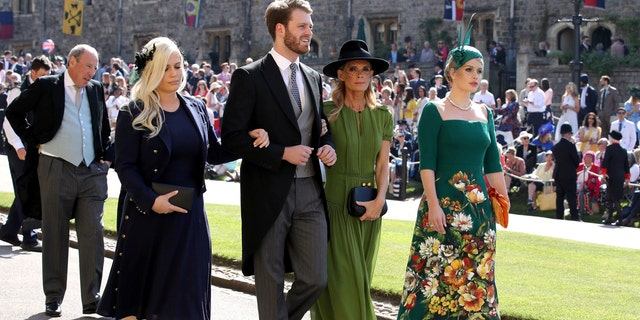 The Spencer family makes their way into St. Georges Chapel for the royal wedding ceremony on Saturday, May 19.