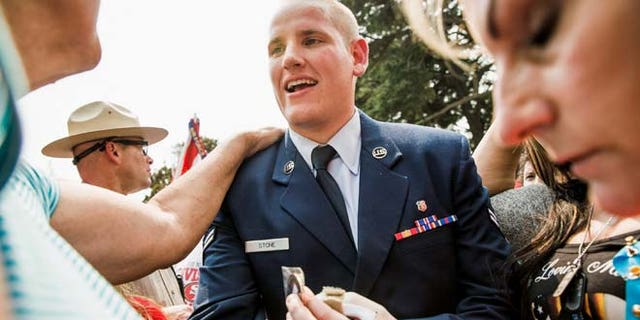 FILE 2015: Spencer Stone, who helped thwart an attack on a French train last August, greets fans in Sacramento. He is in stable condition after being stabbed four times in the chest.