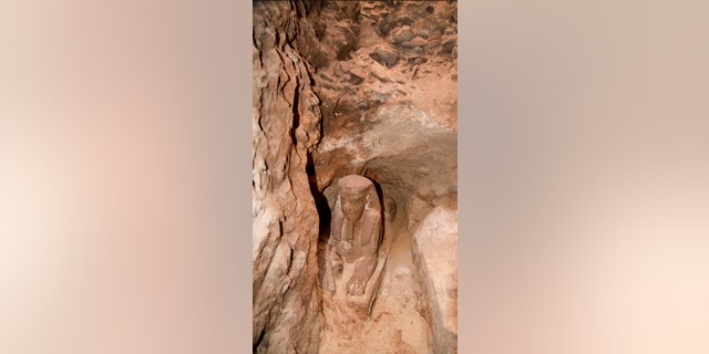 This undated photo released by the Egyptian Ministry of Antiquities, shows the latest discovery of a statue with a lion's body and a human head, in the Temple of Kom Ombo in Aswan, Egypt (Egyptian Ministry of Antiquities via AP)