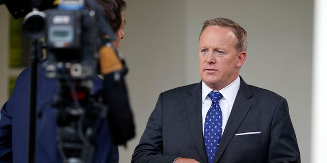 White House press secretary Sean Spicer does a television interview at the White House, Friday, June 23, 2017, in Washington. (AP Photo/Alex Brandon)