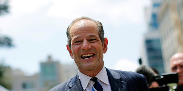 Former New York Governor Eliot Spitzer campaigns in New York, July 8, 2013.  REUTERS/Brendan McDermid/File Photo - TM3ECAB0WXS01