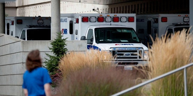 Ambulances line up outside Sacred Heart Hospital following reports of a shooting in Rockford, Wash., Sept. 13, 2017.