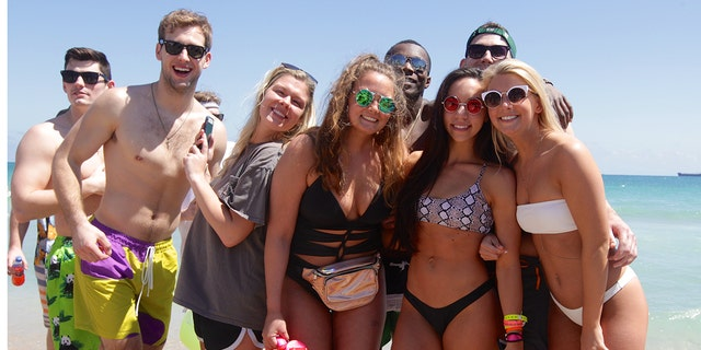 Katelyn (in white bikini on right) from Illinois Wesleyan University said she's seen 'people constantly blacking out'