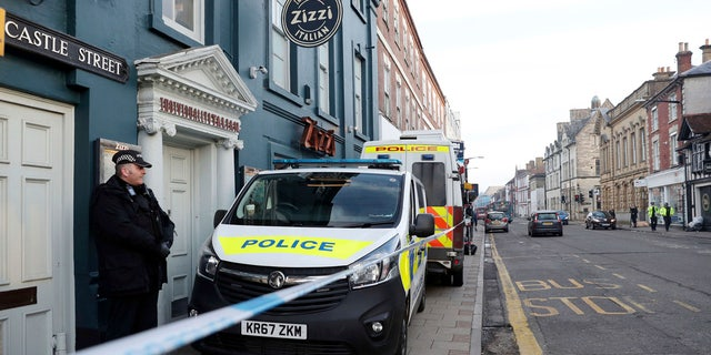 A policeman stands outside the Zizzi restaurant in Salisbury, England Wednesday, March 7, 2018 near to where former Russian double agent Sergei Skripal was found critically ill.