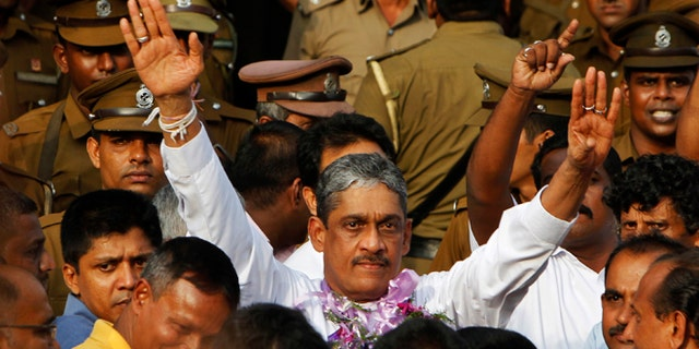 May 21, 2012: Sri Lanka's former army chief Sarath Fonseka waves to his supporters as he walks out of a jail in Colombo, Sri Lanka.
