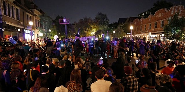 Protesters gather, Friday, Sept. 15, 2017, in St. Louis, after a judge found a white former St. Louis police officer, Jason Stockley, not guilty of first-degree murder in the death of a black man, Anthony Lamar Smith, who was fatally shot following a high-speed chase in 2011. (AP Photo/Jeff Roberson)
