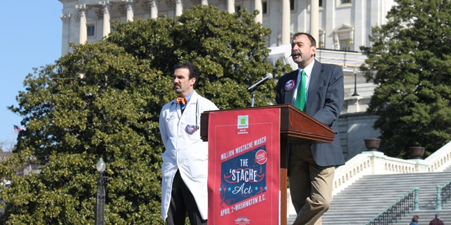 Feb. 20, 2012: Aaron Perlut, left, chairman of the American Mustache Institute, and John Yeutter of Northeastern State University promote a proposal to give a $250 tax refund to mustached Americans.