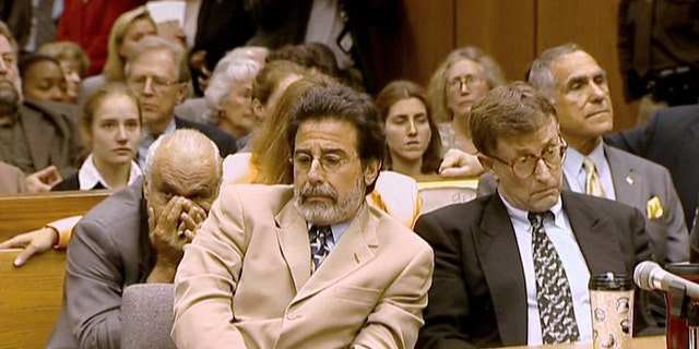 Michael Peterson, right, and his attorney David Rudolf after Peterson's guilty verdict is announced at his trial in 2003.