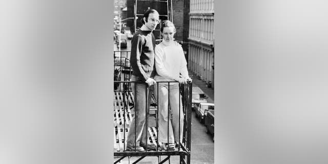 Stan and Julie Patz on the second-floor fire escape of the of their SoHo loft in 1980.