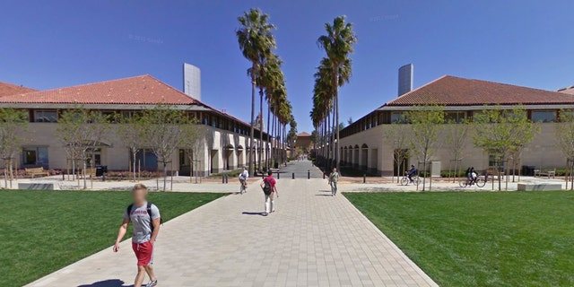 Students walk on the campus of Stanford University in California.