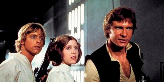 """From left: Mark Hamill as Luke Skywalker, Carrie Fisher as Princess Leia Organa, and Harrison Ford as Hans Solo in the original 1977 """"Star Wars: Episode IV - A New Hope."""""""