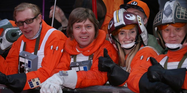 """""""Star Wars"""" fans gather at the film's premiere in London on Tuesday, and soon astronauts get to watch it in space."""