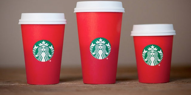 Starbucks' new holiday cup is has a simple red design devoid of the regular designs.