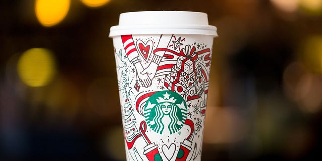The hands above the Starbucks logo on the holiday cups are causing a stir for possibly belonging to lesbians.