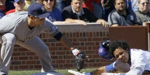 Sept. 21, 2011: Milwaukee Brewers third baseman Jerry Hairston Jr., left, tags Chicago Cubs' Starlin Castro out at third, as Castro tried to stretch his double into a triple during the first inning of a baseball game in Chicago.