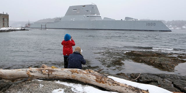 Dave Cleaveland and his son, Cody, photograph the USS Zumwalt.