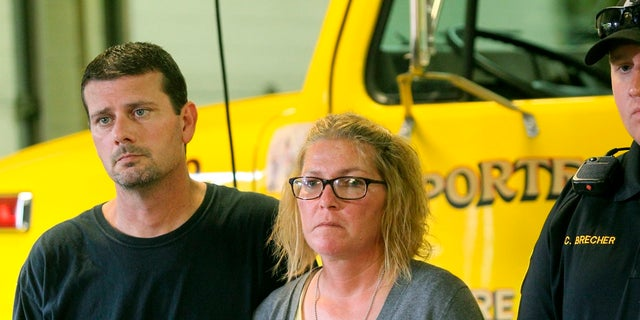 Jeremy Neiswonger [left] and Jake Wilson's mother Megan Neiswonger seen here at a press conference on Thursday, August 16, 2018.