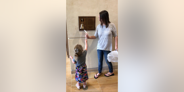 "Stephanie shared a photo of her and her daughter ringing a ""chemo bell"" signaling the end of treatment."