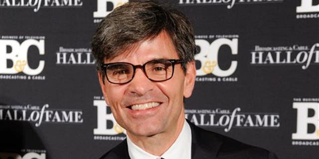 """FILE - This Oct. 20, 2014 file photo shows George Stephanopoulos at the 24th Annual Broadcasting and Cable Hall of Fame Awards in New York. Stephanopoulos has apologized for not notifying his employer and viewers about two contributions totaling $50,000 that he made to the Clinton Foundation. ABC's news division said Thursday, May 15, 2015, that """"we stand behind him."""" The donations, made in two installments in 2013 and 2014 and first reported in Politico, were made because of Stephanopoulos' interest in the foundation's work on global AIDS prevention and deforestation, he said. (Photo by Evan Agostini/Invision/AP, File)"""