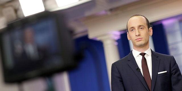 Senior White House Advisor Stephen Miller waits to go on the air in the White House Briefing Room in Washington, U.S., February 12, 2017.  REUTERS/Joshua Roberts - RTSYA17