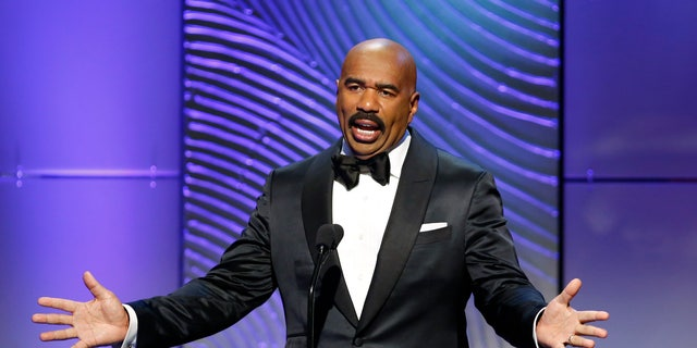 """TV host Steve Harvey presents the outstanding morning program award during the 40th annual Daytime Emmy Awards in Beverly Hills, California June 16, 2013. Harvey hosts """"Family Feud."""""""