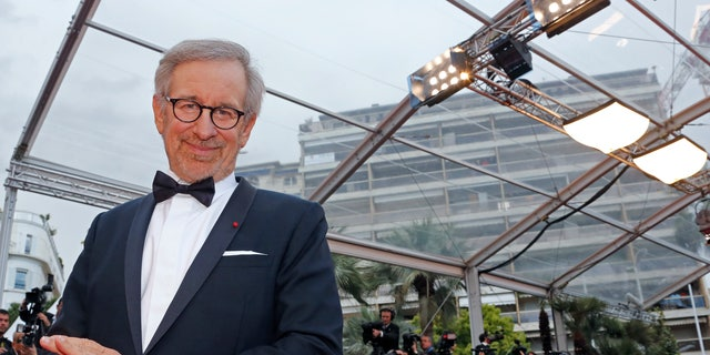 """May 19, 2013. Director Steven Spielberg, Jury President of the 66th Cannes Film Festival, poses on the red carpet as he arrives for the screening of the film """"Inside Llewyn Davis"""" in competition during the 66th Cannes Film Festival in Cannes."""