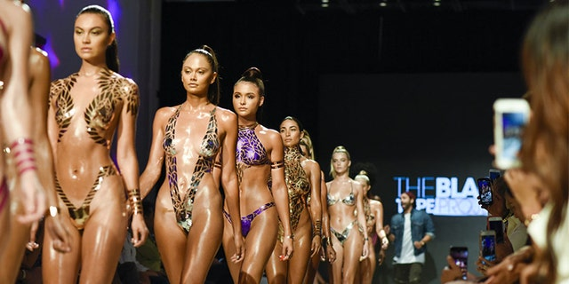 Models walked the runway at Miami Swim Week wearing stick-on swimwear.