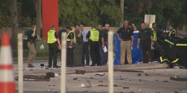 Investigators at the site of the deadly crash in Pinellas County, Florida.