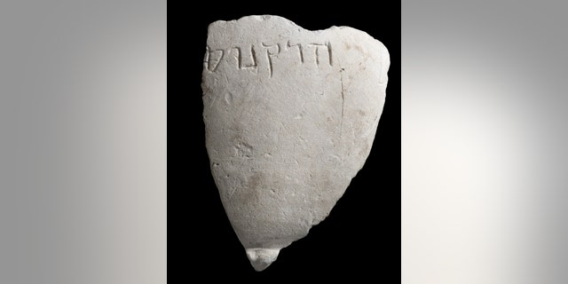 """A fragment of the chalk bowl from the Hasmonean period, which is engraved with the name """"Hyrcanus"""". (Photographic credit: Clara Amit, Israel Antiquities Authority)"""
