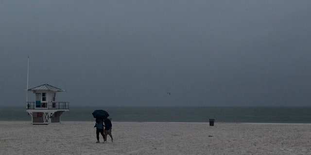 Rain falls on Clearwater Beach by Pier 60 early Sunday morning May 27, 2018, as northbound Subtropical Storm Alberto looms in the gulf to the southwest. as northbound Subtropical Storm Alberto looms in the gulf to the southwest.