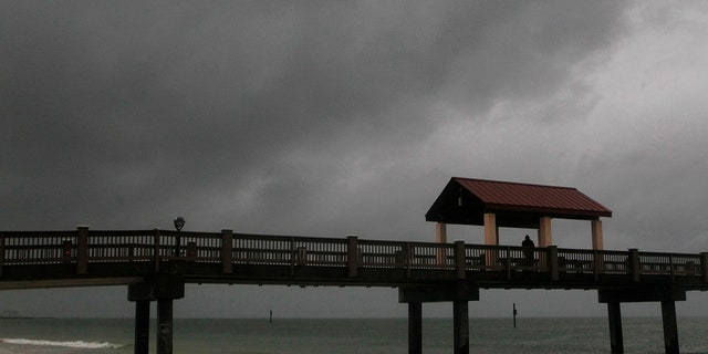 Rain falls on Clearwater Beach by Pier 60 early Sunday morning May 27, 2018, as northbound Subtropical Storm Alberto looms in the gulf to the southwest.