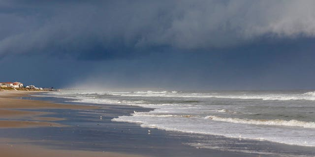 A storm front is seen on the beach in North Topsail Beach, N.C., prior to Hurricane Florence moving toward the east coast on Wednesday, Sept. 12, 2018. Hurricane Florence is putting a corridor of more than 10 million people in the crosshairs as it closes in on the Carolinas, uncertainty over its projected path spreading worry across a wider swath of the Southeast. (AP Photo/Tom Copeland)