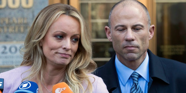 Stormy Daniels and her attorney, Michael Avenatti, outside the courthouse in lower Manhattan Monday.