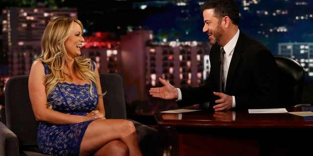 """This image released by ABC shows adult film star Stormy Daniels, left, laughs with host Jimmy Kimmel during an appearance on """"Jimmy Kimmel Live!"""" Tuesday, Jan. 30, 2018, in Los Angeles. (Randy Holmes/ABC via AP)"""