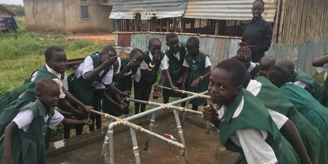 Good Shepherd Academy students at their well in Juba, Sudan