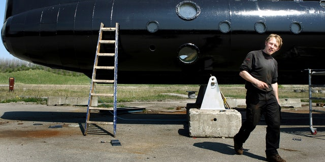 Submarine owner Peter Madsen stands in front of the home-built sub.
