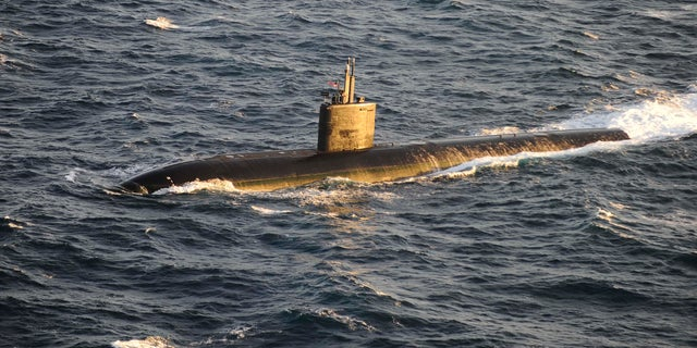 The Los Angeles-class attack submarine USS Montpelier (SSN 765) operates under its own power in the Atlantic Ocean in this October 14, 2012 handout photo. (REUTERS/Mike DiMestico/U.S. Navy/Handout)