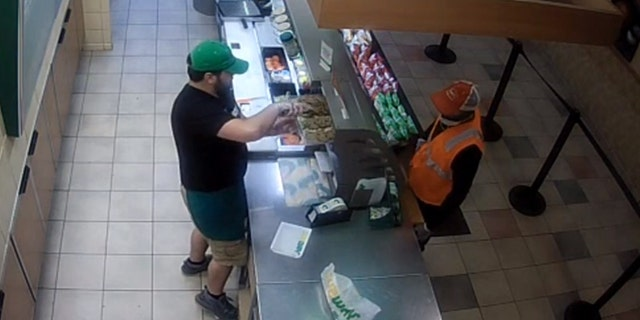 The suspect's posed as a construction worker, ordering a meal and dessert while his face was obscured by a dust mask.