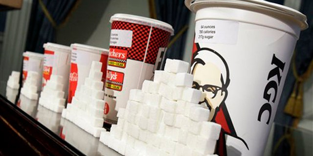 May 31, 2012: This photo shows a display of various size cups and sugar cubes at a news conference at New York's City Hall.