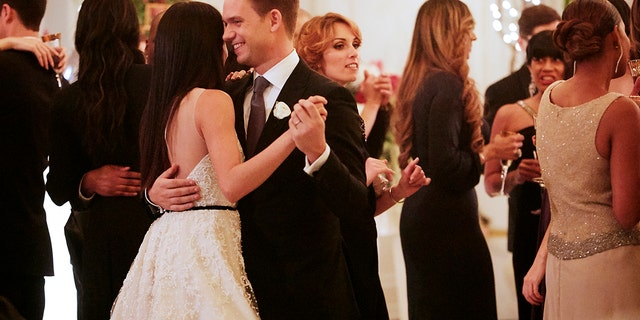 Markle and Patrick J. Adams share the first wedding dance during their 'Suits' wedding.
