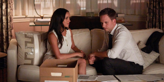 """SUITS -- """"Full Disclosure"""" Episode 707 -- Pictured: (l-r) Meghan Markle as Rachel Zane, Patrick J. Adams as Michael Ross -- (Photo by: Shane Mahood/USA Network)"""