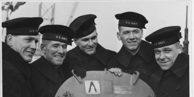 The Sullivan brothers photographed on board the USS Juneau, 14 Feb. 1942 From left to right: Joseph, Francis, Albert, Madison and George Sullivan (Courtesy U.S. Naval History and Heritage Command)