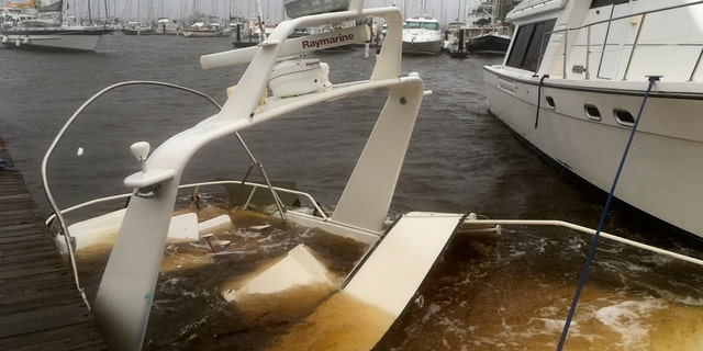 The mast of a sunken boat sits at a dock at the Grand View Marina in New Bern, N.C., on Friday, Sept. 14, 2018. Winds and rains from Hurricane Florence caused the Neuse River to swell, swamping the coastal city.