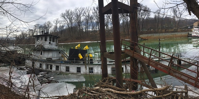 Coast Guard Marine Safety Unit Huntington members are responding to a sunken vessel with reports of discharging product near mile marker 8 on the Big Sandy River near Butler, W.V., on Wednesday