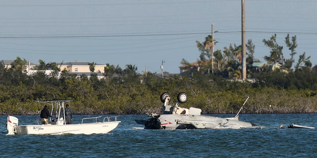 U.S. Navy personnel responded to the F/A-18 Super Hornet that crashed on its approach to Naval Air Station Key West in Florida on Wednesday.