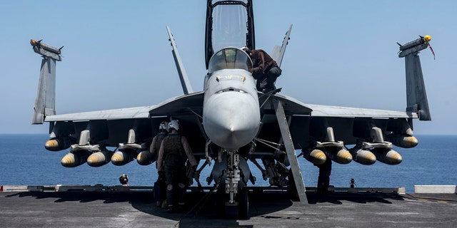This undated photo shows an F/A-18E Super Hornet on board the USS George H.W. Bush in the Mediterranean Sea